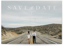 This is a white save the date by Leah Bisch called la vie with standard printing on signature in grand.