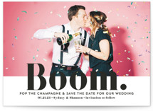 This is a black save the date by Erika Firm called BOOM Pop the Champagne with standard printing on smooth signature in grand.