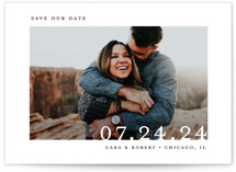 This is a white save the date by Lindsay Megahed called Minimal Message with standard printing on signature in grand.