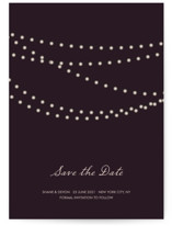 This is a purple save the date by Design Lotus called Midnight Vineyard with standard printing on signature in grand.