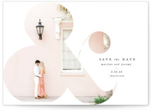 This is a white save the date by Lori Wemple called Elegant Ampersand with standard printing on signature in grand.