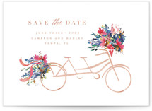 This is a orange save the date by Lori Wemple called Bicycle for Two with standard printing on signature in grand.