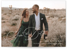 This is a white save the date by Jennifer Postorino called Serenade with standard printing on signature in grand.