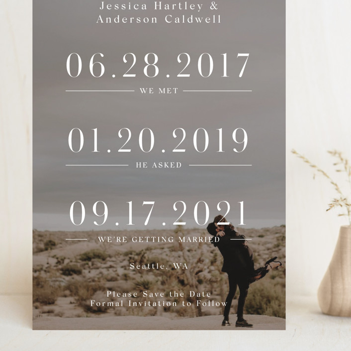 """""""Timing"""" - Grand Save The Date Cards in Ivory by Mayflower Press."""