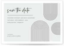This is a blue save the date by Shari Margolin called Deco Do with standard printing on signature in grand.
