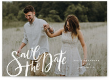 This is a white save the date by Wildfield Paper Co. called Summertime Love with standard printing on signature in grand.