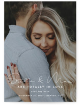 This is a white save the date by Guess What Design Studio called totally in love with standard printing on signature in grand.