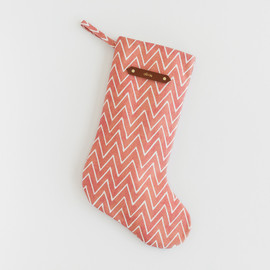 This is a red stocking by Hooray Creative called Watercolor Chevrons.