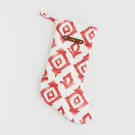 This is a red stocking by Honeybunch Studio called Moroccan Diamonds.