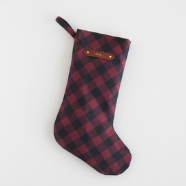 This is a black stocking by Sarah Brown called Painterly Plaid.