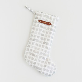 This is a white stocking by SylvieCeres Designs called Positive Negative Bows.