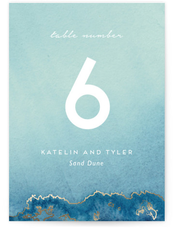 This is a blue, gold Table Numbers by Kaydi Bishop called Sea Crest with Foil Pressed printing on Signature in Classic fold over (blank inside) format. Foil pressed table numbers enhance the look of your tablescape and put the finishing ...
