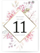 This is a gold table number by Poi Velasco called Ascent with foil-pressed printing on doublethick in standard.