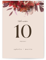 This is a gold table number by Leah Bisch called Autumn Hymnal with foil-pressed printing on doublethick in standard.
