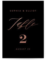This is a black table number by Angela Thompson called Simple Elegance with foil-pressed printing on doublethick in standard.