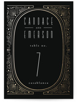 This is a black table number by Ana de Sousa called Deco Starbust with foil-pressed printing on doublethick in standard.
