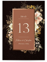 This is a black table number by Wildfield Paper Co called Midnight Spring with foil-pressed printing on doublethick in standard.