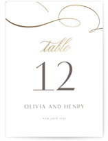 This is a white table number by Jen Banks of Ink and Letter called Forever And with foil-pressed printing on signature in standard.