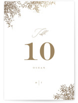 This is a white table number by Leah Bisch called Reflection with foil-pressed printing on signature in standard.