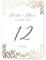 This is a white table number by Laura Hankins called Vine + Pen with foil-pressed printing on signature in standard.