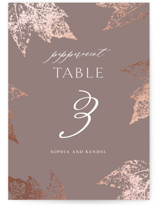 This is a brown table number by Lori Wemple called autumne with foil-pressed printing on signature in standard.