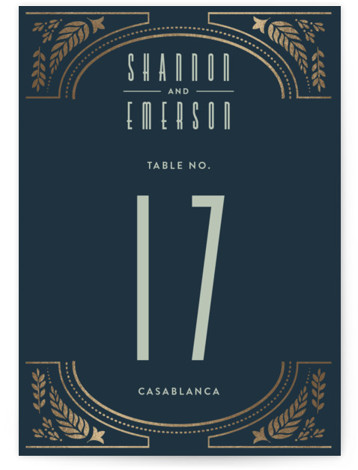 This is a blue, gold Table Numbers by Ana de Sousa called Gilded Love with Foil Pressed printing on Signature in Classic fold over (blank inside) format. A wedding card featuring a leaf pattern.