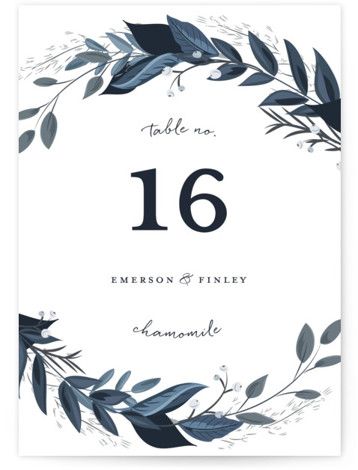 This is a blue, white Table Numbers by Susan Moyal called Vines of Green with Standard printing on Signature in Classic fold over (blank inside) format. This wedding invitation features an array of fresh greenery.