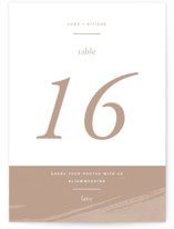 This is a brown table number by Blustery August called Luna with standard printing on signature in standard.