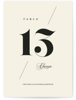 This is a beige table number by Anastasia Makarova called Big Date with standard printing on signature in standard.