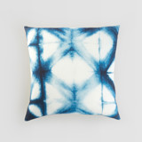This is a blue pillow cover by Agnes Pierscieniak called Indigo Diamond.
