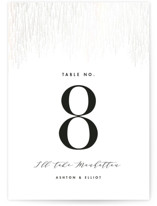 This is a white table number by Kristie Kern called Sparkle + Shine with gloss-press printing on doublethick in standard.