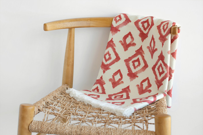 .Danish chair with woven seat and beautiful soft red and white throw