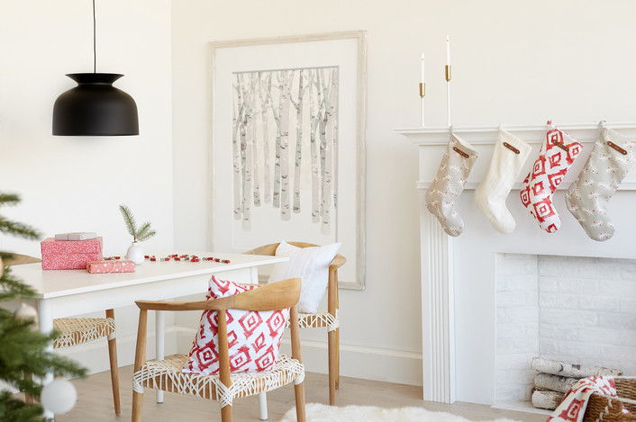 Swedish Christmas decor with Danish chairs, pastels, black pendant light and stockings