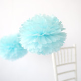 """This is a blue tissue paper pom pom by Minted called Seafoam 14""""."""