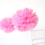 """This is a pink tissue paper pom pom by Minted called Petal 14""""."""