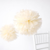"This is a brown tissue paper pom pom by Minted called Cream 14""."