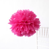 "This is a pink tissue paper pom pom by Minted called Fuchsia 18""."
