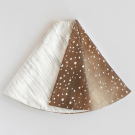 This is a brown tree skirt by Multiple Artists called Snow Covered Woods.