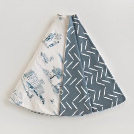 This is a blue tree skirt by Multiple Artists called Atlanta Modern Toile.