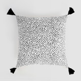 This is a black and white pillow cover by Up Up Creative called Effervesce.