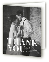 This is a black and white wedding thank you card by Jill Means called Ribbon Border with standard printing on strathmore in standard.