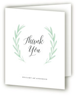This is a white wedding thank you card by Olivia Raufman called Painted Leaves with standard printing on strathmore in standard.
