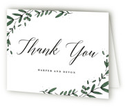 This is a green wedding thank you card by Kelly Schmidt called Floral Wreath with standard printing on strathmore in standard.