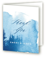 This is a blue wedding thank you card by Ariel Rutland called misty forest with standard printing on strathmore in standard.