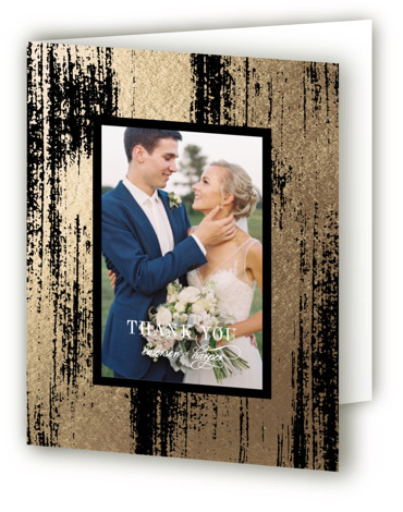 This is a portrait modern, black Wedding Thank You Cards by Kelly Schmidt called Gold Leaf with Foil Pressed printing on Standard Cover in minibook fold over (blank inside) format. Painted gold brush strokes frame elegant type