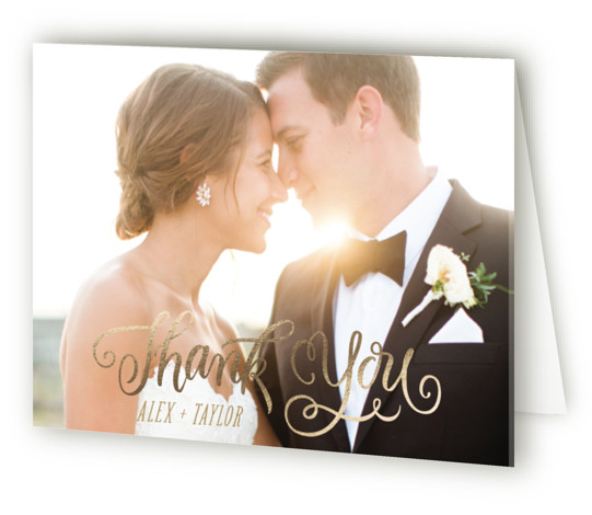 This is a landscape whimsical, gold Wedding Thank You Cards by Laura Bolter Design called Happily Ever After Begins with Foil Pressed printing on Standard Cover in minibook fold over (blank inside) format. Beautiful, swirling calligraphy for a storybook beginning. ...