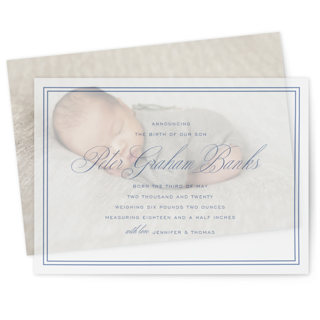 This is a blue vellum overlay birth announcement by Toast & Laurel called Scholarly Charm with standard printing on translucent vellum in overlay.