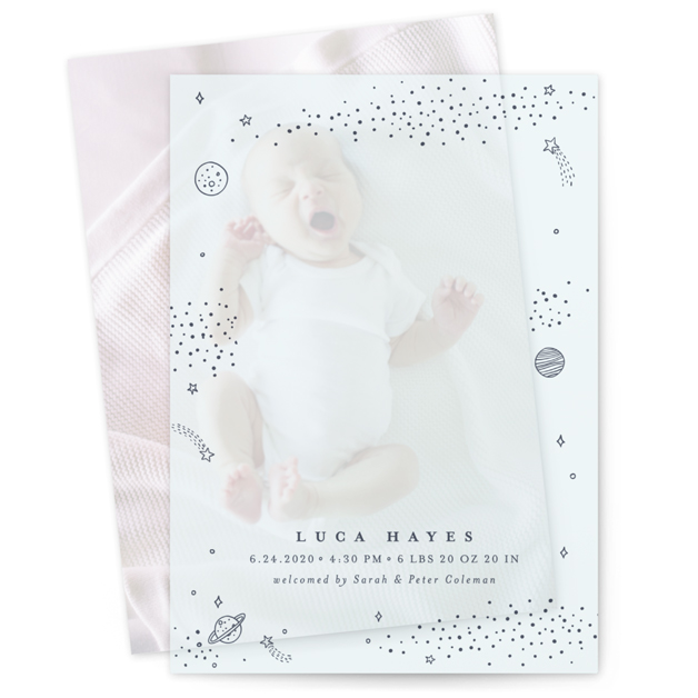 This is a blue vellum overlay birth announcement by Monika Drachal called Out of This World with standard printing on translucent vellum in overlay.
