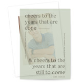 This is a green vellum graduation announcement by Blustery August called Cheers with standard printing on translucent vellum in overlay.