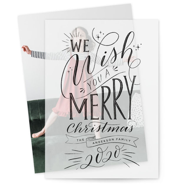 This is a black vellum holiday card by Nicole Barreto called Hand-lettered Wish with standard printing on translucent vellum in overlay.